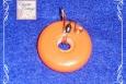 Orange wire wrapped pendant