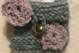 Green and tan felted pouch