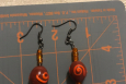 Rust and orange dangle earrings