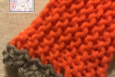 Grey trim on orange fingerless gloves, USA