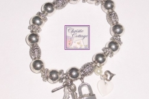 heart charm bracelet, key, lock
