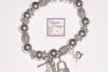 heart charm bracelet, key, lock