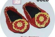 Red shoes with crocheted blossom